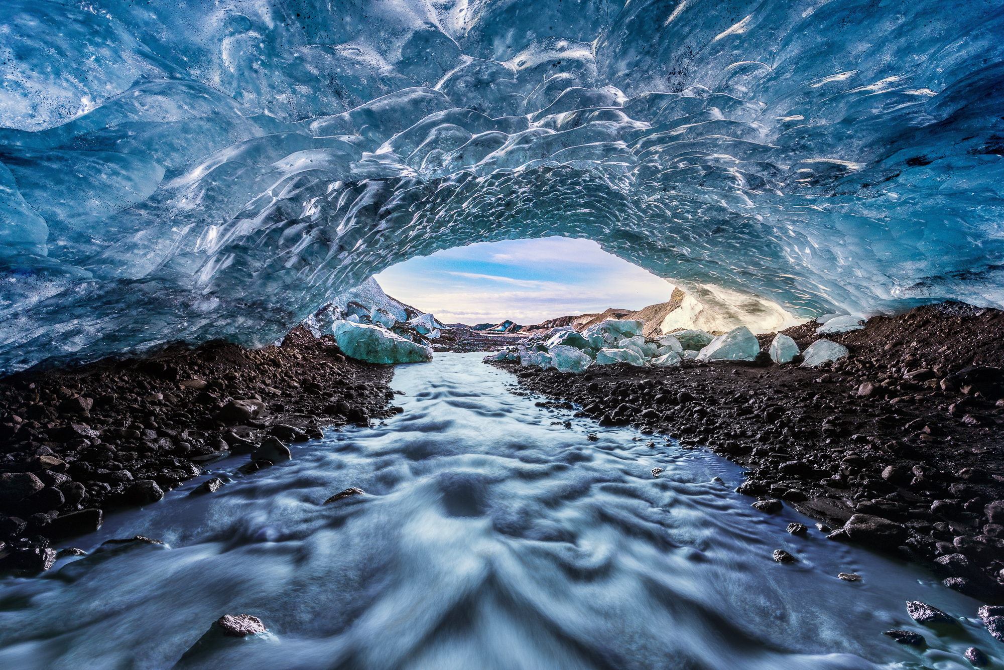 Water Flowing Out of Glacial Ice Cave, Iceland