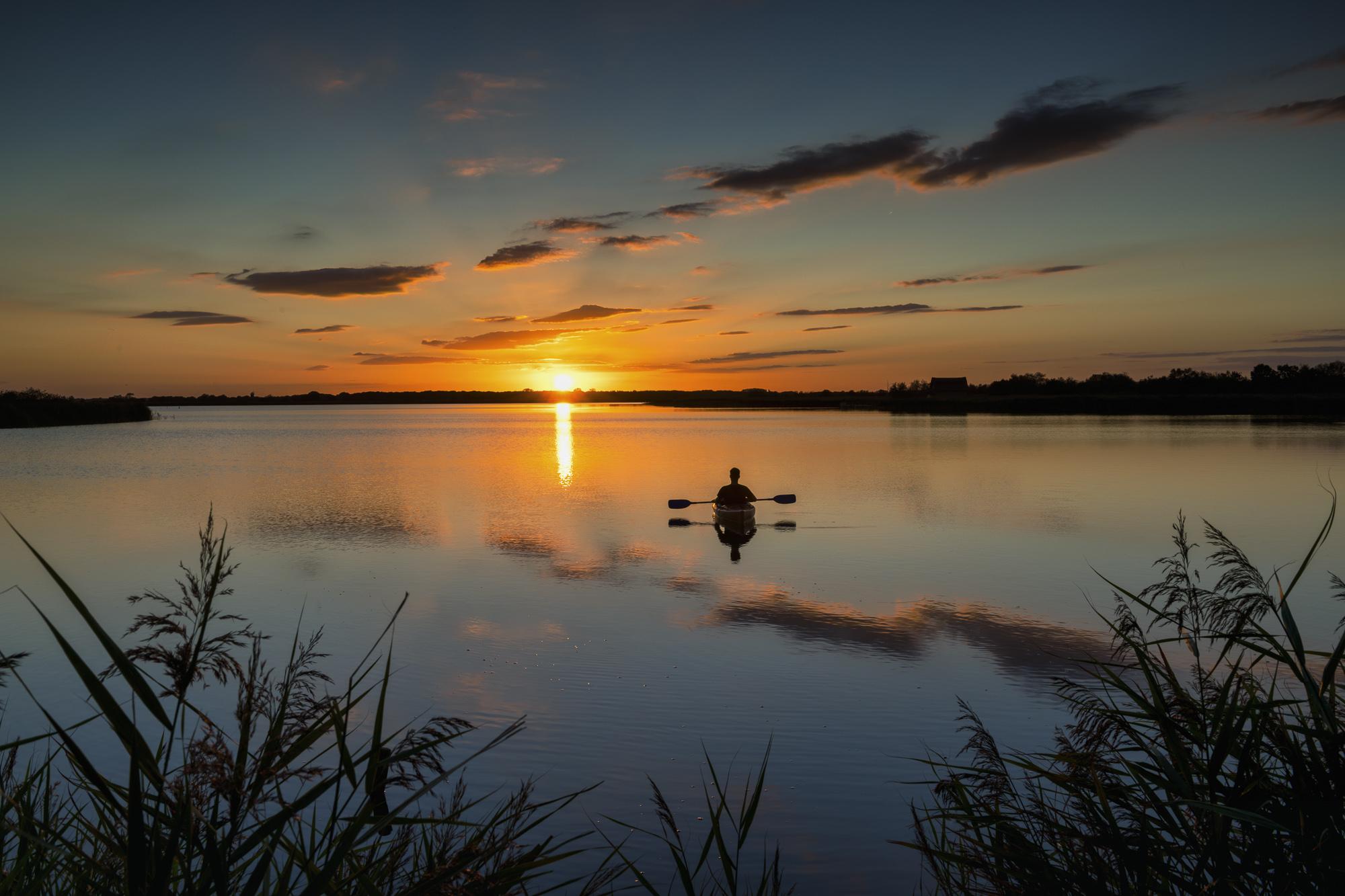 Kayaker at Sunset, Norfolk Broads National Park, Norfolk, England