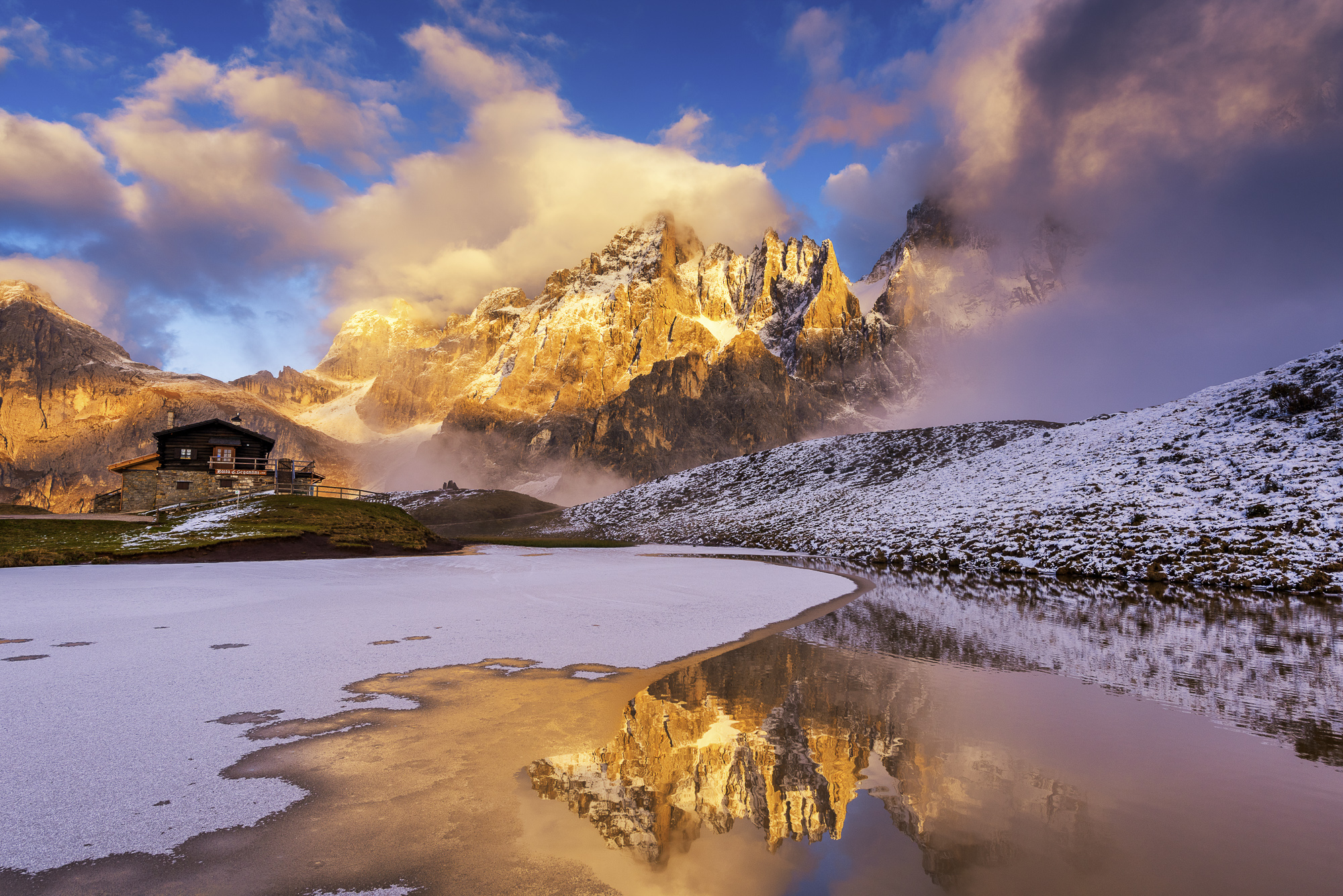 Pale di San Martino Reflecting in Partially Frozen Lake, Dolomites, Trentino, Italy