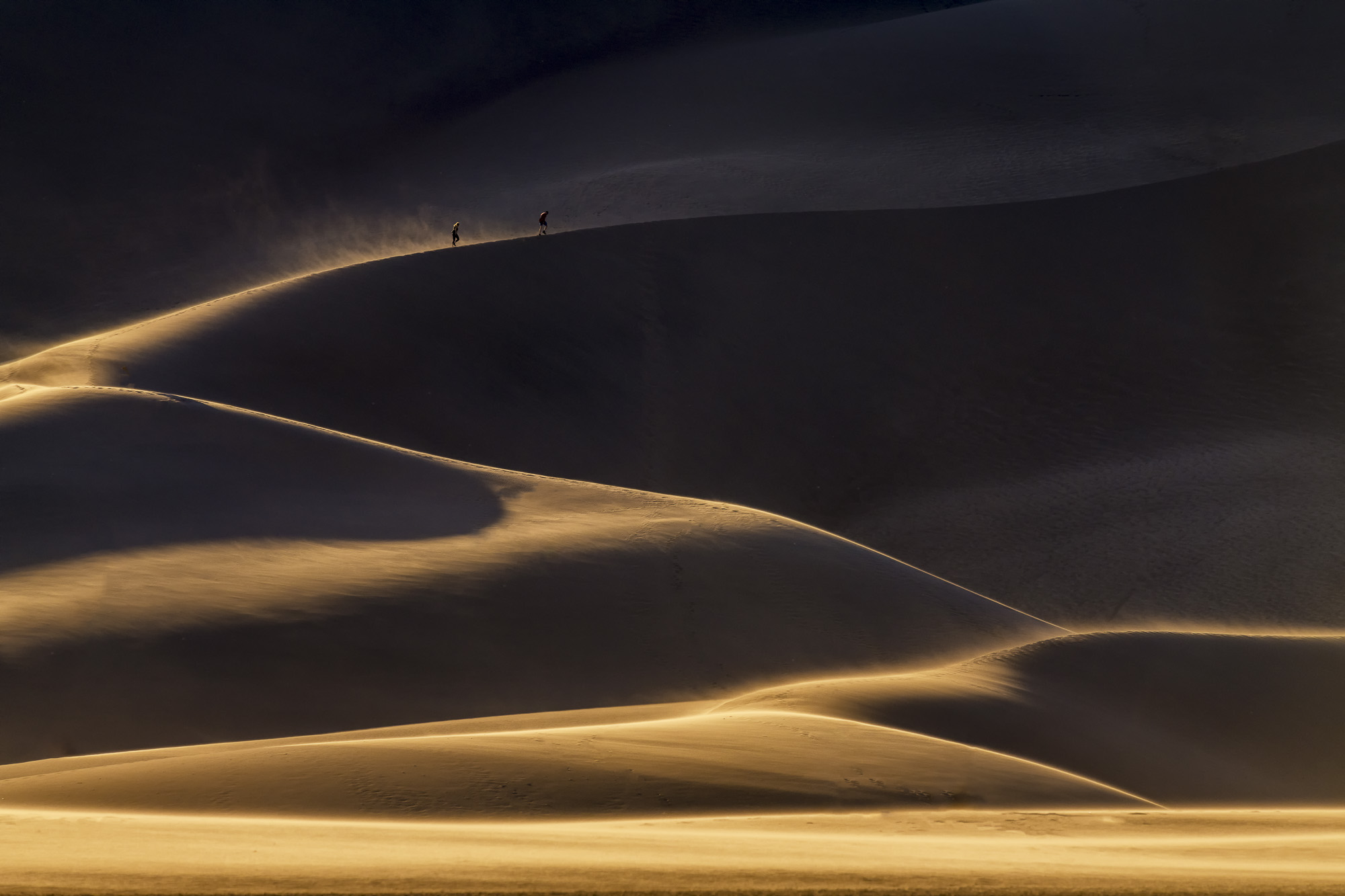 People Hiking Up Sand Dunes, Great Sand Dunes National Park, Colorado, USA
